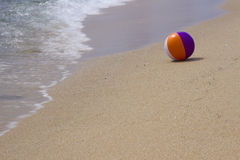 The ball on the sea shore Royalty Free Stock Photography
