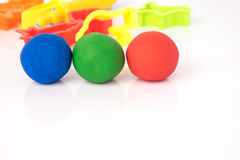Ball shape of play dough on white background. Colorful play dough Stock Images