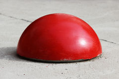 Ball-shaped concrete pedestals near the house beside the road against the entry of vehicles. Relevant when the danger of terrorist. Ball-shaped red concrete Royalty Free Stock Photography