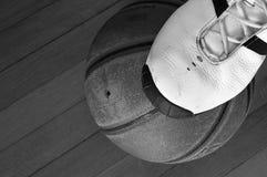 Ball and shoe. Basketball players shoe on the ball, on gym floor stock photography
