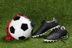 Ball and shoes for football with a whistle for the referee, on the green field stock photos