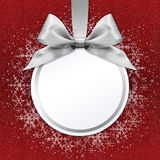 Ball with silver satin ribbon bow on red background Stock Photography