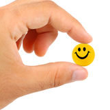 Ball with smile between the fingers Royalty Free Stock Photos