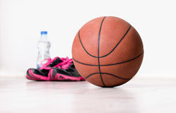 Ball and sneakers for basket Stock Photography