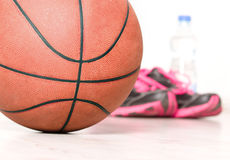 Ball and sneakers for basket Stock Photo