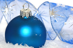 Ball on snow background. Blue Christmas ball on snow background Royalty Free Stock Images