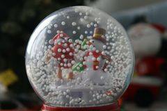 Snowman in a glass ball - decoration stock photography