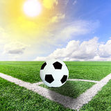 Ball on soccer field with blue sky Royalty Free Stock Photos