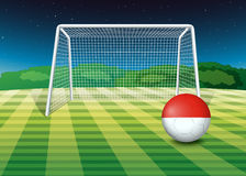 A ball at the soccer field with the flag of Monaco Royalty Free Stock Photos