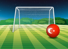 A ball at the soccer field with the flag of Turkey Stock Image