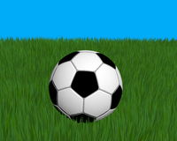 Ball. Soccer ball on green grass, on blue background, created in 3d Studio Max Royalty Free Stock Photography