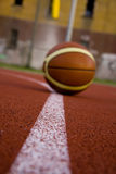 Ball in sport parquet Royalty Free Stock Image