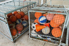 Ball sports equipment store in the cage. Royalty Free Stock Photography