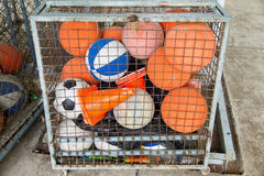 Ball sports equipment store in the cage. Stock Photos