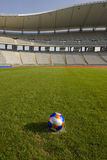 Ball at the stadium. Soccer ball in the stadium at the penalty point Stock Image