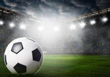 Ball on stadium Stock Images