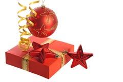 Ball, stars, streamer and gift box Stock Image