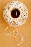 Ball of String. Rough string and brown card, for a feeling of recycling and using natural rescources economically royalty free stock photos