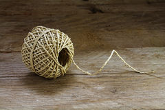 Ball of string  texture and strands on a rustic wooden backgroun Royalty Free Stock Image