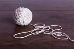 Ball of string on a wooden background Stock Photography