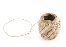 Ball of strong brown string over white background Stock Photo