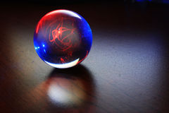 The ball of success and happiness. Gazing into the future from a magic ball filled with electricity Stock Photo