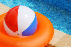 Ball and swimming circle near pool Stock Photography