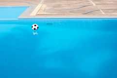Ball and swimming pool Royalty Free Stock Image