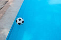 Ball and swimming pool Royalty Free Stock Photography