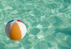 Ball in swimming pool. Ball in sparkling water in swimming pool Royalty Free Stock Images