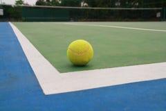 Ball on tennis court Stock Photos