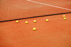 Ball on tennis court background Stock Photo