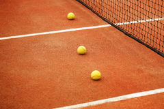 Ball on tennis court background Royalty Free Stock Photos