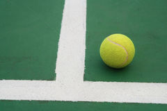 Ball on tennis court Stock Image