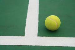 Ball on tennis court. Near line Stock Image