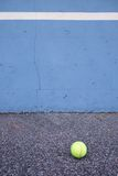 Ball beside tennis training wall. Empty training tennis court Stock Images