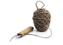 Ball of thick string and knife Stock Images
