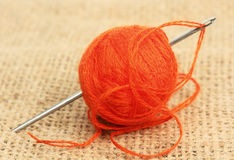 A ball of thread and needle Royalty Free Stock Photos