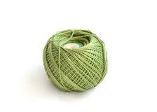 Ball of threads. Green wool ball on a white background Royalty Free Stock Photography