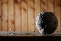 Ball of threads on an old table Stock Photos
