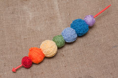 Ball of the threads strung on spoke Royalty Free Stock Photos