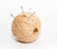 Ball of threads with the thrust pins on a white background Stock Images