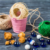 Ball of threads on wooden background Stock Image