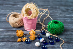 Ball of threads on wooden background Stock Photo
