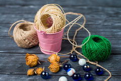 Ball of threads on wooden background Royalty Free Stock Image