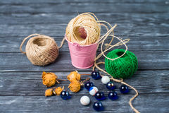 Ball of threads on wooden background Royalty Free Stock Photos