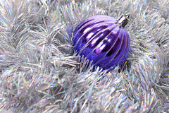 Ball and tinsel  background. New-year decorations. Christmas ball and tinsel  background Royalty Free Stock Photos