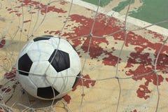 Ball in to the futsal goal Stock Photo