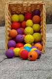 Ball toy for dogs wicker basket Royalty Free Stock Photography