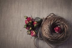 Ball of twine with  dried roses bouquet Royalty Free Stock Images